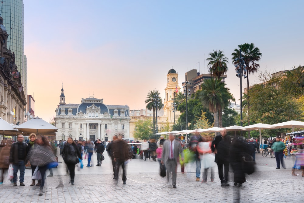 Santiago, Region Metropolitana, Chile - June 06, 2016: A view of buildings an people at Plaza de Armas, the main square of Santiago de Chile and a gathering point for tourists, immigrants and Chilean citizens.
