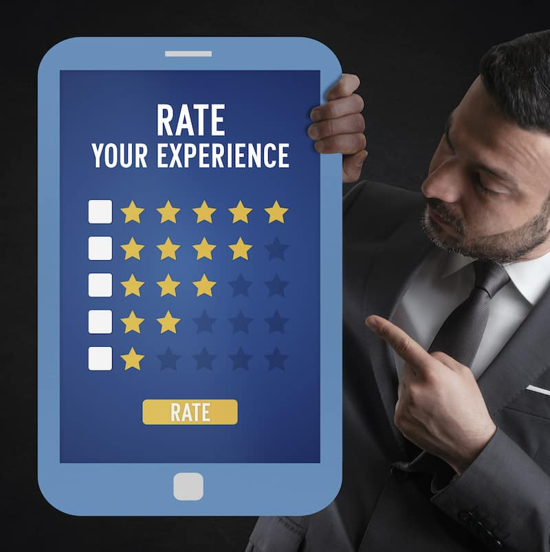 man holding tablet that says rate your experience